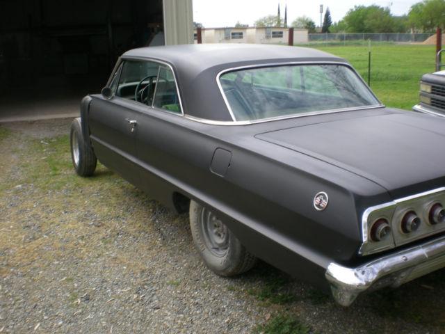 seller of classic cars 1963 chevrolet impala black brown. Black Bedroom Furniture Sets. Home Design Ideas