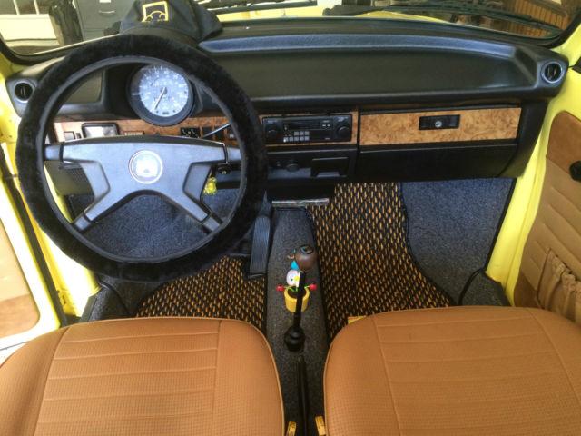 seller of classic cars 1979 volkswagen beetle classic lemon yellow tan. Black Bedroom Furniture Sets. Home Design Ideas