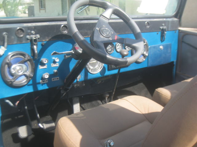 seller of classic cars 1971 jeep cj teal green tan and black. Black Bedroom Furniture Sets. Home Design Ideas