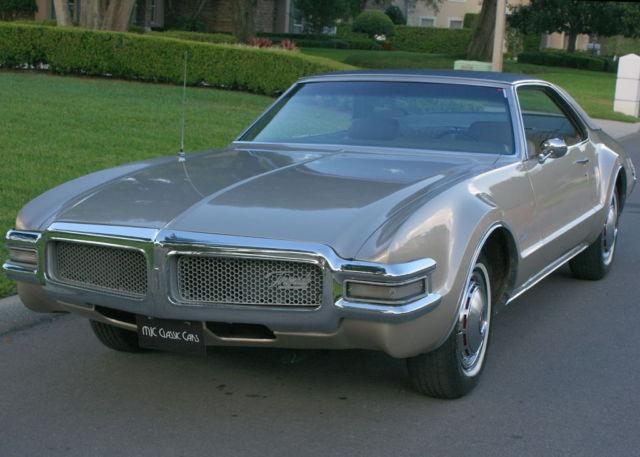 seller of classic cars 1968 oldsmobile toronado gold metallic tan. Black Bedroom Furniture Sets. Home Design Ideas