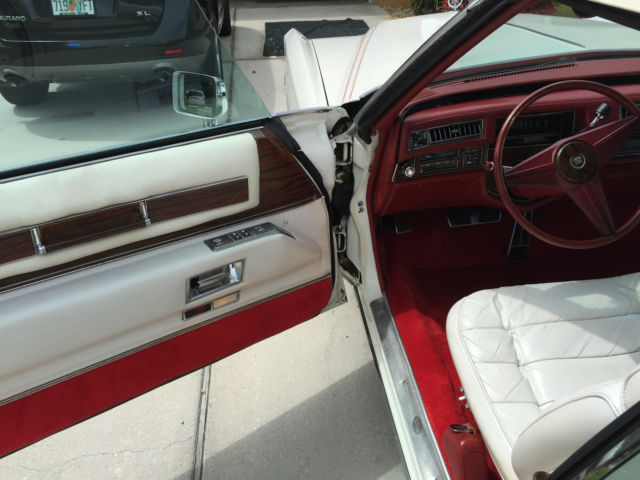 seller of classic cars 1976 cadillac eldorado white red carpet and dash with white leather seats. Black Bedroom Furniture Sets. Home Design Ideas
