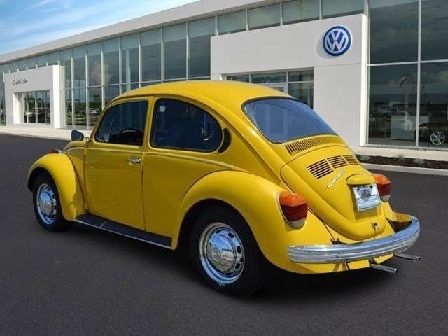 seller of classic cars 1973 volkswagen beetle classic yellow black. Black Bedroom Furniture Sets. Home Design Ideas