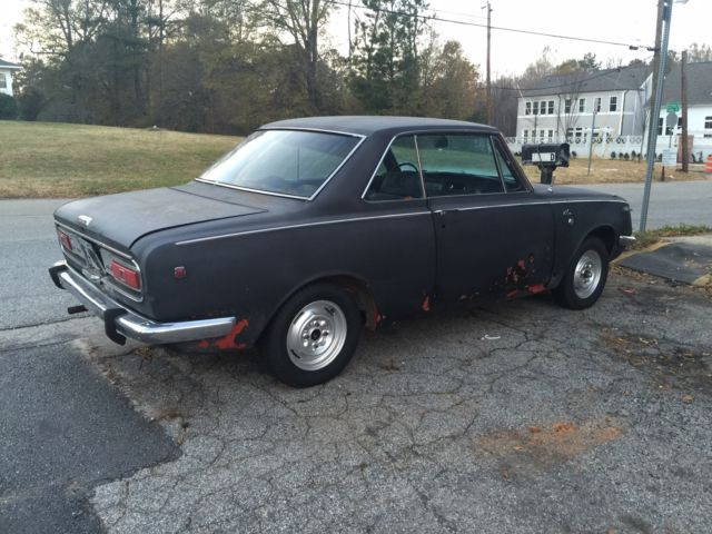 seller of classic cars 1970 toyota corolla red black. Black Bedroom Furniture Sets. Home Design Ideas