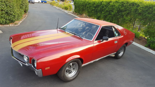 1969 AMC AMX (Matador Red, Gold Stripes/Charcoal Black)