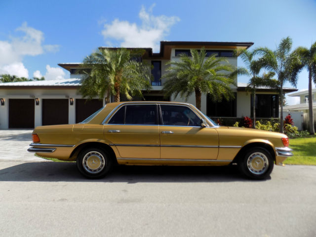 1977 Mercedes-Benz 200-Series (Ikon Gold Metallic/Black cloth)