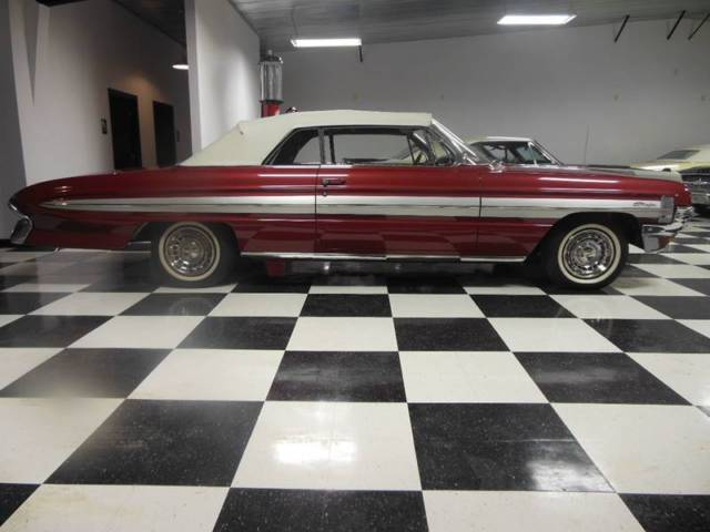 1961 Oldsmobile Starfire (Red/Maroon)