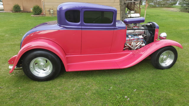 1931 Ford Model A (Pink and Purple/Grey seats with wood paneling)