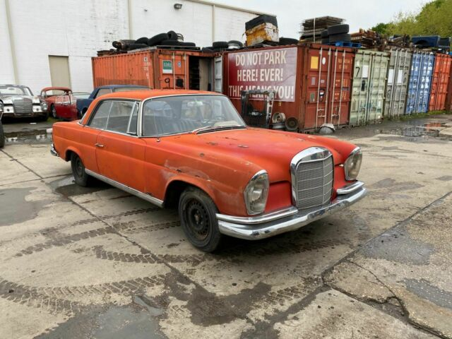 1967 Mercedes-Benz 200-Series (Red/Black)
