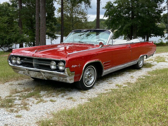 1964 Oldsmobile Starfire (Red/White)